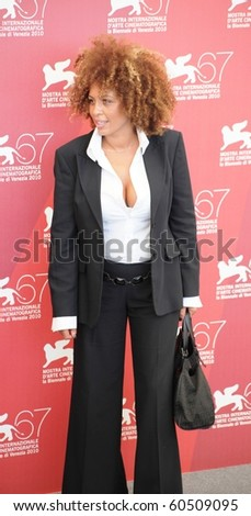 VENICE, ITALY - SEPTEMBER 04: MâBarka Ben Taleb poses for photographers on the red carpet at 67th Venice Film Festival September 04, 2010 in Venice, Italy. - stock photo