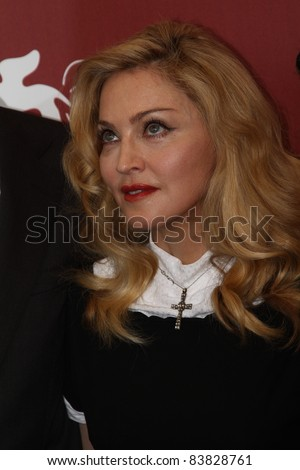 VENICE, ITALY - SEPTEMBER 01: Madonna arrives at the 'W.E.' photocall at the Palazzo Del Cinema during the 68th Venice Film Festival on September 1, 2011 in Venice, Italy.