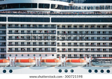 VENICE, ITALY - SEPTEMBER 14, 2014: MSC Fantasia cruise ship with passengers floats in Venice, Italy. MSC Fantasia is the largest cruise ship ever built for a European ship owner.