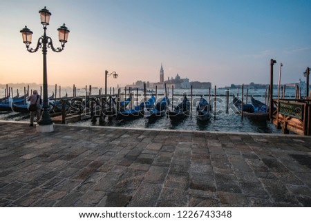 Venice, Italy, September 17, 2018 - Tourist take pictures sunrise on the waterfront next to the Doge Palace #1226743348