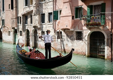 VENICE, ITALY - SEPTEMBER 31: Tourists on a Gondola, September 31, 2011 in Venice, Italy. The city has an average of 50,000 tourists a day and it's one of the world's most internationally visited city