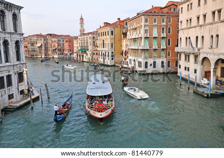 VENICE, ITALY - SEPTEMBER 27: Tourists travel by vaporetto on the Grand Channel on September 27, 2009 in Venice, Italy. Vaporetto (water bus) is the most common way of transportation in Venice.
