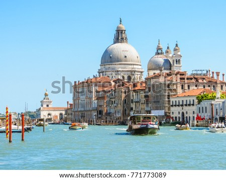 VENICE, ITALY - SEPTEMBER 6, 2013: Water traffic on the Grand Canal near Basilica Santa Maria della Salute, Venice, Italy #771773089