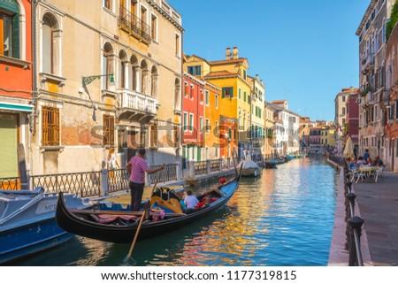 Venice, Italy - 16.08.2018: Tourists travel on gondolas at canal Venice, Italy. #1177319815