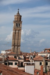 Venice, Italy. View of historical rooftops and a crooked or leaning tower.