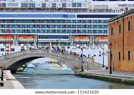 VENICE - JUNE 12: Cruise ship crossing Grand canal on June 12, 2011 in Venice, Italy. More than 20 million tourists come to Venice annually.