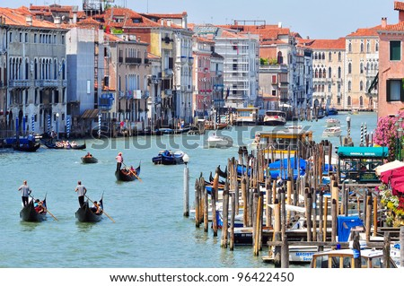 VENICE - JUNE 12: Tourists visit the Grand canal on June 11, 2011 in Venice, Italy . More than 20 million tourists come to Venice annually.