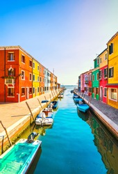 Venice landmark, Burano island canal, colorful houses and boats, Italy Europe