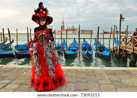 VENICE - MARCH 7: An unidentified masked person in costume in St. Mark's Square during the Carnival of Venice on March 7, 2011. The 2011 carnival was held from February 26th to March 8th.