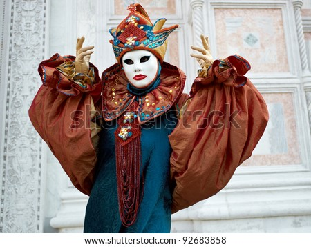 VENICE - MARCH 5: Person in Venetian costume attends the Carnival of Venice, festival starting two weeks before Ash Wednesday and ends on Shrove Tuesday, on March 5, 2011 in Venice, Italy.