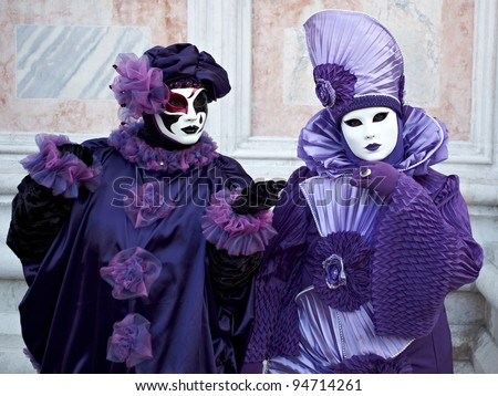 VENICE - MARCH 5: Two people in Venetian costumes attend the Carnival of Venice, festival starting two weeks before Ash Wednesday and ends on Shrove Tuesday, on March 5, 2011 in Venice, Italy.