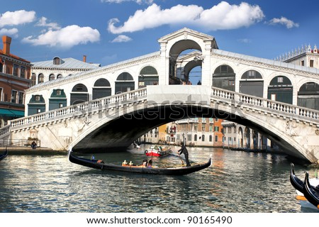 Venice, Rialto bridge with gondola in Italy