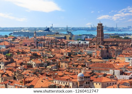 Venice roofs and the port with a cruiseship, aerial view