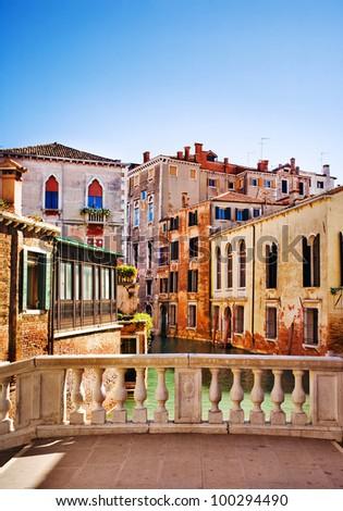 Venice small canal and bridge, Italy - stock photo