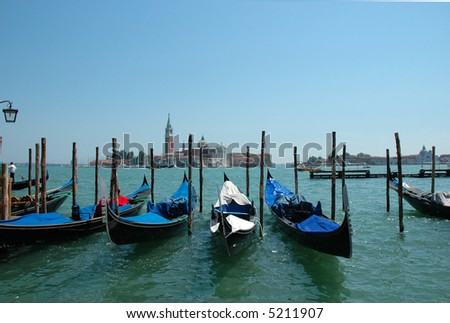 Venice- St. Giorgio in the background, with covered gondolas in the foreground