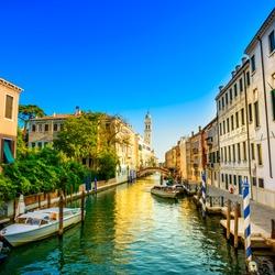 Venice sunset cityscape, San Giorgio dei Greci water canal and church campanile. Italy, Europe.