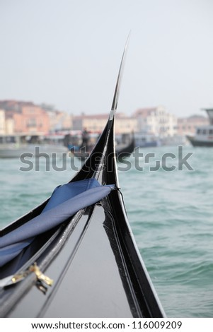 Venice - the Pearl of Italy. Gondola in Venice canal near Piazza San Marco. Shallow DOF.