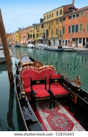 Venice: traditional gondola waiting for a romantic ride. - stock photo