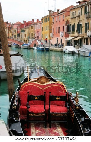 Venice: traditional gondola waiting for a romantic ride