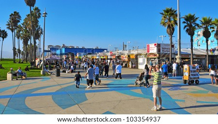 VENICE, US - OCTOBER 17: Ocean Front Walk of Venice Beach on October 17, 2011 in Venice, US. This boardwalk is 2.5 kilometer long and full of colorful shops and food stalls