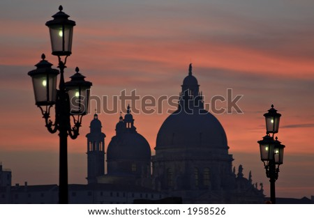 Venice view at night. In the background - church  St. Maria della Salute.