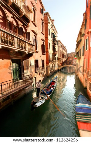 Venice with gondola on canal in Italy
