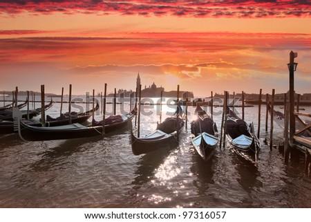 Venice with gondolas on Grand Canal against San Giorgio Maggiore church