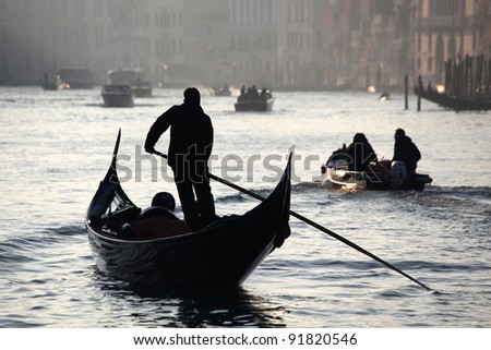Venice with Gondolier on Grand Canal, Italy