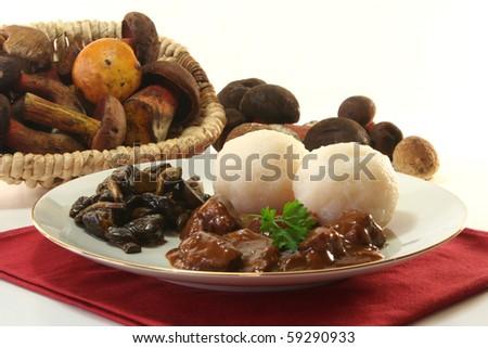 Venison goulash with dumplings and fresh mushrooms