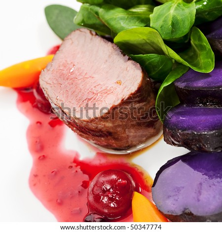 Venison Meat with Carrots, Zucchini, Herbs and Potato. With Sauce and Red Berries
