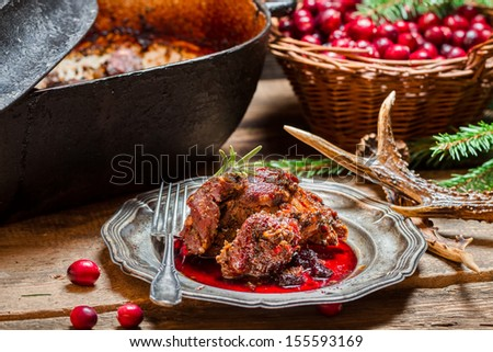 Venison with cranberry sauce and rosemary straight from the forest