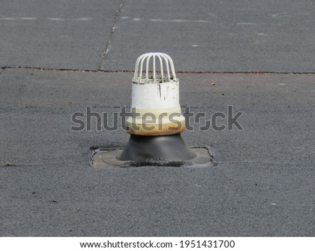Vent on a new flat roof stock photo