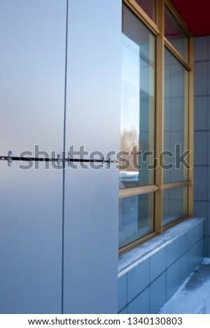 Ventilated facade. Russia. Grey ceramic tiles/ Damage #1340130803