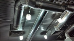 Ventilation. Ventilation pipes with grille. Ventilation system. Photo ventilation pipe. Industrial background