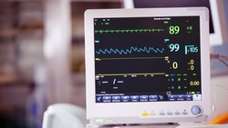 Ventilator monitor vital signs, EKG, ECG, Electrocardiographic selective focus against operating room, emergency room in the hospital, intensive therapy, treatment, critical or care unit, ICU ITU CCU