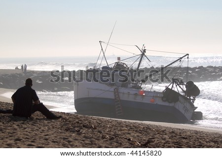 VENTURA, CA - JANUARY 8 : Fishing boat SAI GON I runs aground after 4 people were rescued early morning January 8, 2010 in Ventura, CA. Rescue team tried to free the boat throughout the day.