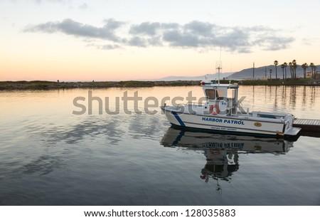 VENTURA, CALIFORNIA - 13 DECEMBER: Ventura Port District Harbor Patrol boat docks at dawn on 13 December 2012. The Harbor commenced operations in 1963.