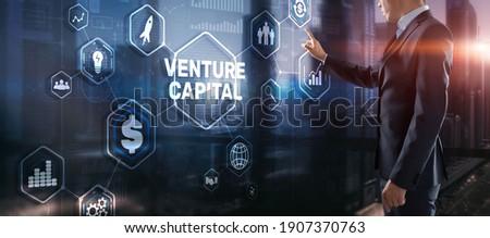 Venture capital. Investor capital. Businessman pressing virtual screen inscription. ストックフォト ©