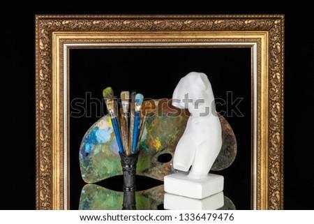 Venus bust artistic brushes palette picture frame on black background
