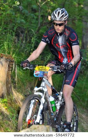 VERBIER, SWITZERLAND - AUGUST 21: Malte Scheidegger in the woods in the Grand Raid mountain bike race:  August 21, 2010 in Verbier Switzerland