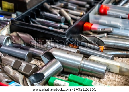 Veriaty of milling tools in a tool box