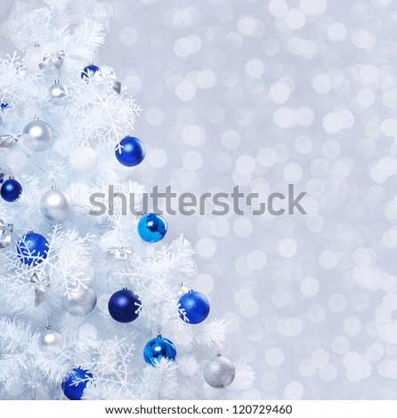 Verical closeup photo of white decorated christmas tree