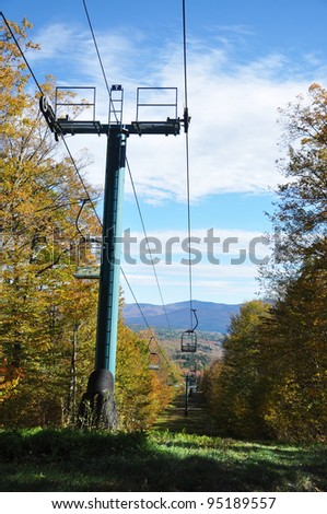 Vermont Fall Foliage and ski lift in forest on Mount Mansfield in Vermont, USA