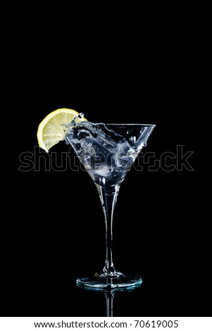 Vermouth cocktail inside martini glass over dark background