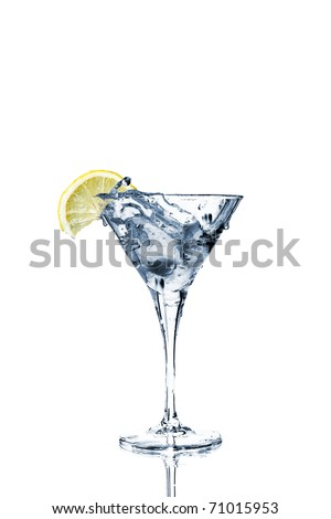 Vermouth cocktail inside martini glass over white background