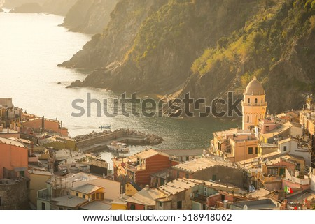 Vernazza, Cinque Terre, Liguria Aerial view of village, famous world heritage Italian site. Church,Fishing harbor with boats, deep blue sea,colorful houses,dramatic coastal scenery at Sunset in Summer #518948062