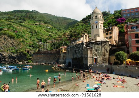VERNAZZA, ITALY - JUNE 12: Tourists play on the beach on June 12 2011 at Vernazza. Vernazza is  part of Cinque Terre. Cinque Terre is a UNESCO World Heritage Site.