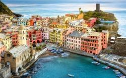 Vernazza village on a rock in Mediterranean sea, Cinque Terre, Liguria coast, Italy