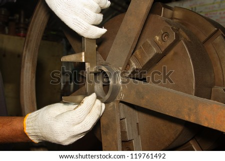 Vernier Caliper and  lathe, turning machine with cutting tool