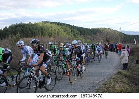 VERNON, FRANCE - MAR 01: Japanese Fumiyuki Beppu in peloton pack riding La Classic Sud Ardeche UCI Europe Tour Pro Race on March 01, 2014 in Versas Hill, Ardeche, France. Florian Vachon won the race.